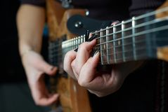 Playing on guitar Royalty Free Stock Photography