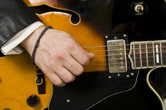Playing guitar. Musician playing guitar; close-up picture Stock Images