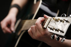 Playing guitar Royalty Free Stock Images