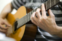 Playing guitar. Man playing an acoustic guitar royalty free stock photography