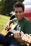 Playing guitar Stock Photos