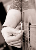 Playing guitar. Close up of a lady playing guitar Stock Photo