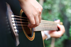 Playing the Guitar. On holiday Stock Image