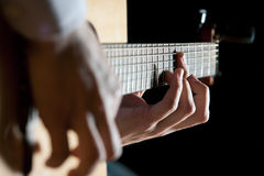 Playing the guitar. Young artist playing the guitar Royalty Free Stock Photos