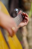 Playing the guitar. Guitar, strings, arms, fingers of a guitar player, vertical Stock Photos