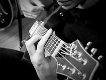 Playing guitar Stock Image