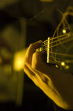 Playing guitar. Shot of hands playing an acoustic guitar royalty free stock photography