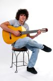 Playing Guitar. A musician plays the guitar Stock Image