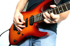 Playing guitar. Man playing electric guitar on white background Royalty Free Stock Images
