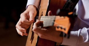 Playing the guitar. Artist playing a beautiful guitar song Stock Photography