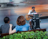 Playing guitar blind beggar in the street Royalty Free Stock Photos