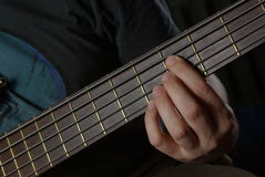 Playing an guitar with brown neck Stock Images