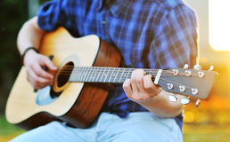 Playing guitar C chord. Outdoors Royalty Free Stock Photos