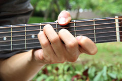 Playing guitar chord F# Stock Photography