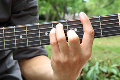 Playing guitar chord F# Stock Photos