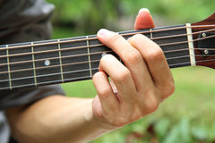 Playing guitar chord G Stock Photos