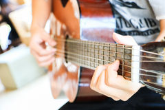 Playing the guitar. Classic style Royalty Free Stock Photography