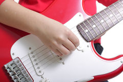 Playing guitar close-up. Hand playing guitar close-up over white background Royalty Free Stock Photos