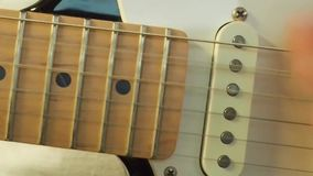 Playing guitar stock video
