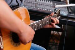Playing guitar. Close-up of man playing guitar Royalty Free Stock Photos