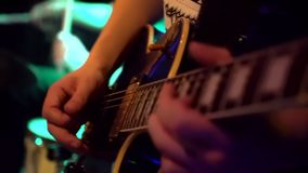 Playing guitar close-up slow motion macro. Guitarist hands pressing chords with fingers on electric guitar. slow-motion stock video footage