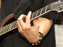 Playing guitar closeup Royalty Free Stock Photo