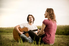 Playing guitar - dating couple Royalty Free Stock Image