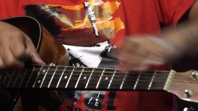 Playing guitar differently stock footage