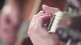Playing guitar - fingers on fretboard. stock video