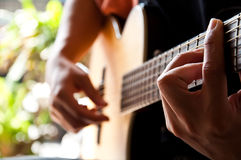 Playing guitar G chord Royalty Free Stock Photography