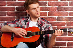 Playing guitar. Stock Photos