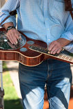 Playing the guitar horizontally. The method of playing the guitar this way is called slide guitar or bottleneck guitar Royalty Free Stock Images