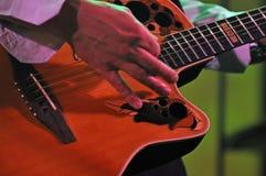 Playing a guitar Stock Photos