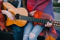 Playing guitar and meeting on roof, close up royalty free stock photography
