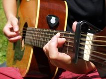Playing the guitar outdoor. Close up with guitar played outdoor Stock Photo