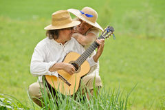 Playing guitar outdoors royalty free stock images