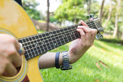 Playing guitar in the park Stock Image