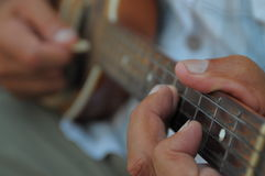 Playing guitar Stock Images