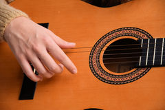 Playing the guitar. Practicing music with a classical guitar Stock Photos