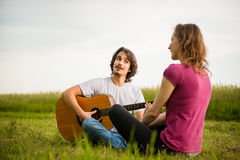 Playing guitar - romantic couple Royalty Free Stock Images