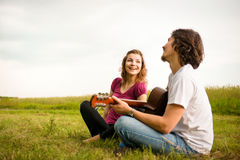 Playing guitar - romantic couple Stock Photo
