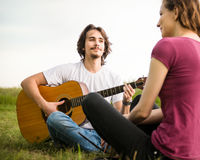Playing guitar - romantic couple Royalty Free Stock Image