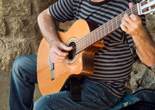 Playing guitar at the street Royalty Free Stock Photo