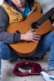 Playing on guitar on the street Stock Photography