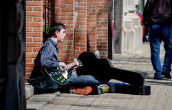 Playing guitar on the street Royalty Free Stock Images