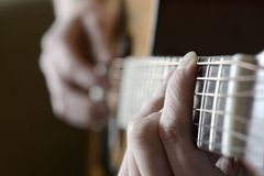 Playing Guitar Strings and Frets Royalty Free Stock Image