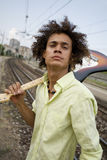 Playing guitar03. Cool guy with his guitar at a train station stock photos
