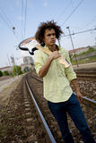 Playing guitar09. Cool guy with his guitar at a train station royalty free stock photography