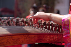 Playing guzheng Royalty Free Stock Image