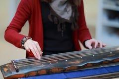 Playing the guzheng Stock Photos